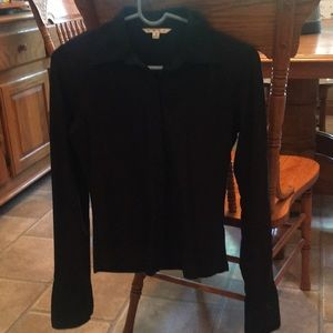 Long sleeve, nylon and spandex. Zipped up front.
